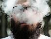 Damian blows cannabis smoke after using a hempwick